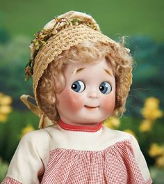 """Petite German Bisque Googly, 221, by Kestner, Size 5 ----11""""-fully jointed toddler body, antique costume. Condition: generally excellent. Marks: A made in Germany 5 JDK 221 Ges Gesch. Comments: Kestner, circa 1912. Value Points: rare small size of the beloved googly with wonderful bisque and expression."""