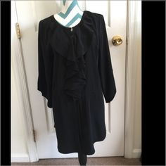 Elle Tunic Absolutely stunning black satin like long tunic. Has beautiful ruffles and button down in the front with a cute drawstring waist. Gorgeous polka dot stitching detail. 3/4 sleeves. Brand new! Pair with leggings or skinny jeans. Elle Tops Tunics