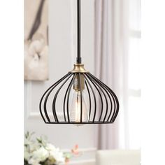 @Overstock - Renate 1-light Distressed Iron Black Teardrop Metal Pendant - This bright teardrop pendant is defined by a metal frame shade and a distressed iron black finish. Offering a single-light design and a 54-inch height, this Renate pendant is sure to add a sophisticated look to any space.  http://www.overstock.com/Home-Garden/Renate-1-light-Distressed-Iron-Black-Teardrop-Metal-Pendant/7411398/product.html?CID=214117 $50.14