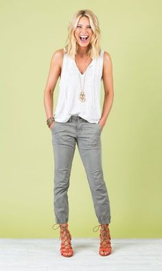 White top, gray pants, strappy sandals