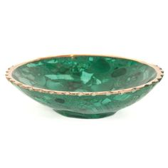 "Small Malachite Bowl  Malachite is believed to be a strong protector of children. It is said to protect the wearer from accidents and protects travelers. Malachite has been used to aid success in business and protect against undesirable business associations. It is a stone of balance in relationships.  This small round malachite bowl with brass scalloped edges is 3 3/4"" in diameter and 1"" tall.  $60.00 USD"
