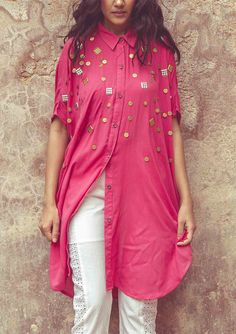 handembroidered rayon shirt tops and shirt This short sleeves kaftan shirt featuring an oversized, shapeless silhouette with wooden button placket and hip pockets. *Dropped shoulders and chunky scattered embellishment for a more updated festive look. *Rounded hem with subtle side vents.
