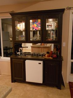 """Homemade Wet Bar! when i couldn't sell my old oak china hutch i spray painted it espresso brown, removed the bottom drawers to put in a mini fridge, and added a 12"""" deep round sink with automatic faucet - voila!!"""