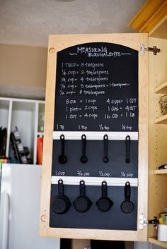 Keep measuring equivalents and measuring cups handy with some hooks, chalkboard paint, and a chalk marker. | 31 Insanely Clever Ways To Organize Your Tiny Kitchen