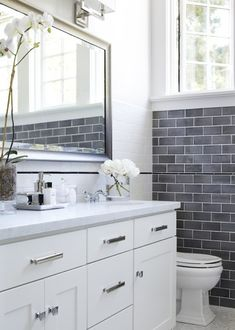 I like subway tile with the oposing grout. White with black and vice versa.