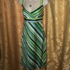 R & K Originals dress Straps can be worn straight over the shoulder or Criss crossed, hits just below my knee. Perfect with denim and sandals or wear with heels for a dressy look. Navy, green, mint, and white with yellow piping. Mint condition. R & K Originals Dresses Midi