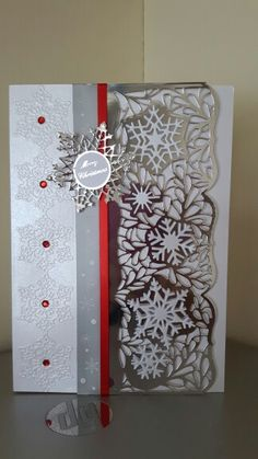 Made by Diane Greaves using tonic die and tattered lace embossing folder strip.