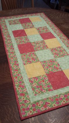 Quilted Table Runner, patchwork pattern, assorted floral fabric, pink, yellow, green