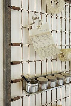 idea of the day: turn an old bed frame into a wall-storage grid - The Snug