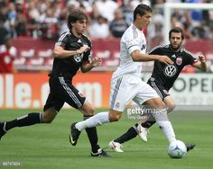 Dejan Janicki #5 and Ben Olsen #14 of D.C United close in on Cristiano Ronaldo #9 of Real Madrid during an international friendly match at Fedex Field on August 9, 2009 #DCU #DCUnited #WeAreUnited