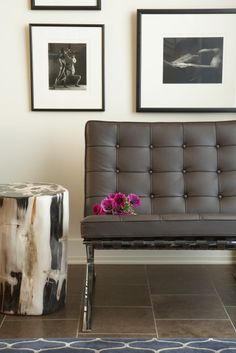 stool, grey barcelona chair, black frames