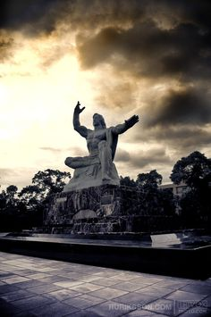 Peace Statue built by the citizens of Nagasaki. It marks the spot of the atomic bomb, one hand points toward the sky to draw awareness to the continuing threat of nuclear weapons while the other symbolizes the need to stay calm and use our intelligence to work toward harmony and global security.