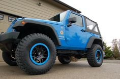 "2012 Jeep Wrangler JK 2 Door - Cosmos blue. Old Man Emu suspension lift, 35"" BFG KM2 mud terrains, KMC XD series rims."