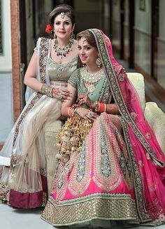 Mother of the Bride - Bride in a Pink and Green Lehenga and the Mother of the Bride in a Beige Net Saree and Marsala Border | WedMeGood | Gold Kaleere and Polki Jewelry #wedmegood #indianwedding #indianbride #motherofthebride #net #beige #pink #polki