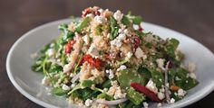 CPK has this great new quinoa salad with arugula, asparagus, sun dried tomatoes, red onions, feta, & toasted pine nuts.  Go try it, their champagne vinaigrette is amazing!  It would probably be good with balsamic too ;)