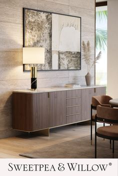 A glamorous take on classic, Mid-Century designs, the timelessly luxurious Dean Sideboard features a gorgeous marble tabletop and chic, metallic accents. It has plenty of storage space and will add instant charm to any space. #sweetpeaandwillow #laskasas #modernsideboard #homedecor #marblefurniture