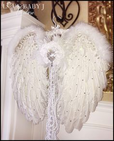 Our luxurious Large Angel Wings are made from a mixture of rooster, turkey, and maribou feathers. The entire front of the wings are sprinkled with top of the line Swarovski crystals. There is also an