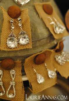 cute way to display earrings: burlap and thumbtacks