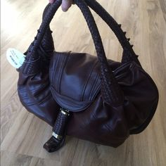 NWT Brown Handbag, faux leather This a brown handbag brand new, faux leather. Bags Shoulder Bags