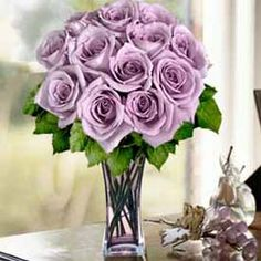 Lavender Roses - I would like to try and incorporate a few of these into my centerpieces