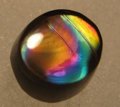 """gorgeousgeology: """" Rainbow Obsidian is black obsidian that, when polished and exposed to a strong light, shows bands of rainbow colours. Rainbow obsidian is said to be the stone used by Nostradamus to. Minerals And Gemstones, Rocks And Minerals, Cool Rocks, Beautiful Rocks, Mineral Stone, Rocks And Gems, Stones And Crystals, Gem Stones, Healing Stones"""