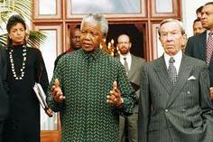 Susan Rice, Nelson Mandela, and Secretary of State Warren Christopher emerge from a meeting After negotiations in Cape Town, South Africa