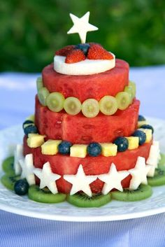 """Fresh Fruit Watermelon """"cake"""" - fantastic way to display fruit at a party! via Apron Strings Blog"""