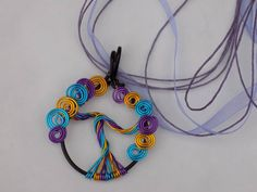 How about a curly tree you can wear. A beautiful summer pendant. They can be made in any colour. Add a touch or rainbow to any outfit.   You can find me on facebook https://www.facebook.com/Theshinyzone