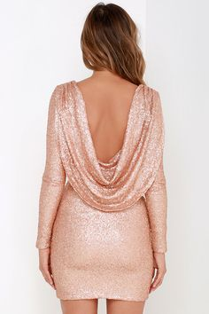 Kick up your heels and lean back, because the Gleam Back Rose Gold Sequin Dress does all the work to make you shine! Stretch knit is coated in shimmering rose gold sequins as it shapes a sultry surplice bodice framed by long, fitted sleeves. A scooping open back elegantly drapes above a bodycon tube skirt for a figure flattering fit that's sure to stun. Hidden side zipper.