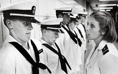"""Every year, the incoming freshman class at Annapolis takes part in """"plebe summer,"""" a demanding six weeks of training run by upper class students.      In 1979, the first class of female students at Annapolis became seniors.  The idea of a woman in a position of power in the military was so novel that this photo of Sandee Irwin putting Don Holcomb through his paces made the front cover of the Washington Post."""