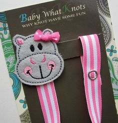 This is an adorable pacifier clip featuring a hippopotamus. One end of the clip has a snap to loop around and attach to the pacifier and the other - Avigayil needs this!
