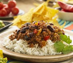 Chilli con carne on rice with corn chips.