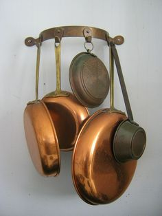 Vintage copper pot rack. This is a half moon style designed to hang from a wall. It has four hooks for hanging pots and pans or other kitchen items. See the first photo where I had it loaded with copper cookware and other items! Items hanging from rack are available in other listings in my shop.    Measures: 12 x 1 3/4 x 4 1/2 width from wall    Condition: vintage, tarnished, needs cleaning, does not come with tools to hang, very sturdy!    Uses: cooking, display, décor, gift, gift ...