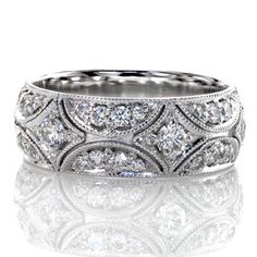 North Star Band -  design contains gleaming micro pavé diamonds set within a unique vintage...