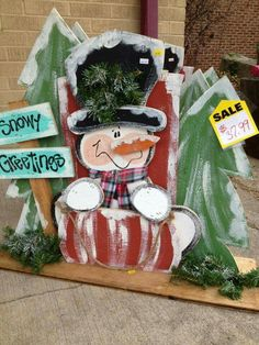 Snowman wood craft.  Snowy greetingd. Yard or home decoration