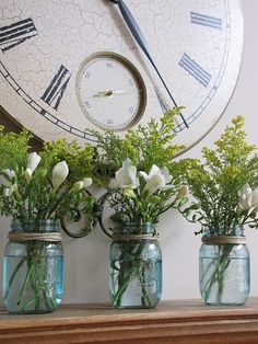 Easy mantle display; canning jar vases with twine, simple floral arrangements, subdued color scheme; (not the clock)