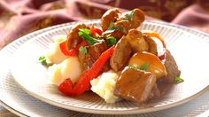 Use red wine, button mushrooms and cubed beef to make this tasty stew ideal for a hearty family feast. Hearty Beef Stew, Stuffed Mushrooms, Stuffed Peppers, Creamy Mashed Potatoes, Tasty, Yummy Food, Soul Food, Dinner Recipes, Cooking