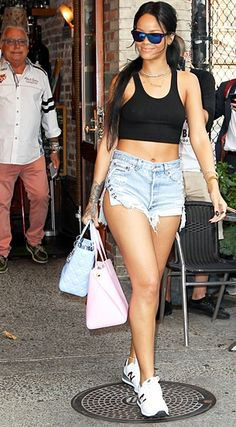 She doesn't have much clothing on, but she did choose supportive footwear #Rihanna