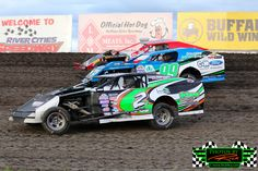 Midwest Modifieds of #2S Matt Schow, #99 Adam Gajeski and #12L Kyle Leake Racing 3 wide at The Legendary Bullring River Cities Speedway. Now That Is Great Racing!