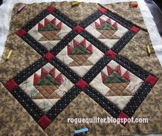 Love the crosshatched stitching on the basket in this tiny quilt!