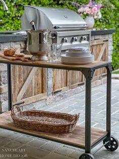 One great surprise was that my favorite rolling cart, that I often use for entertaining, matched perfectly with our new rustic, built in BBQ. It also fits perfectly in the area adjacent to the BBQ, so I have started using is as a mobile bar, snack and buffet table. Bright Decor, Bright Rooms, Outdoor Kitchen Design, Outdoor Kitchens, E Design, Yard Design, Built In Bbq, Stainless Steel Doors, Bbq Area