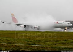 Iberia 6313 from Madrid landing with a horrible rain storm, and full thrust reverse in action!. EC-JPU. Airbus A340-642. JetPhotos.com is the biggest database of aviation photographs with over 3 million screened photos online!