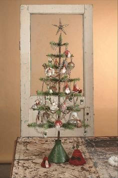 Old fashioned Feather Christmas tree.  soft, real goose feathers embossed tin base  Shelley B Home and Holiday