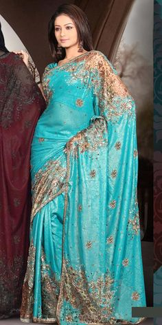 A sari or shari, is an Indian female garment that consists of drape varying from two to nine yards in length and two to four feet in breadth that is typically wrapped around the waist, with one end draped over the shoulder, baring the midriff.