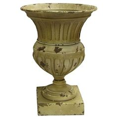 """This Distressed White Metal Planter would be great for displaying fresh or faux flowers; it even looks great standing alone.    It measures approximately 14 1/4"""" x 10 1/2"""". It is for decoration only; not food safe."""