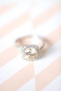 Cushion cut halo with a champagne diamond.