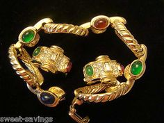 JOAN RIVERS BRACELET AND MATCHING CLIP EARRINGS.  GOLD TONE WITH RED, GREEN AND BLUE CABACHONS.