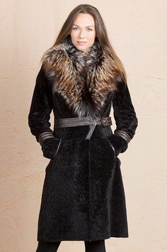 This semi-fitted coat showcases the short, tight Astrakhan lamb fur, crowned with a collar of Finn silver fox fur lined in soft leather. Free shipping   returns.