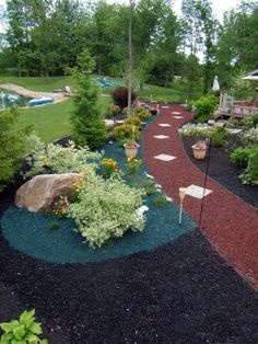 You can create your own unique space with recycled rubber mulch. Available in brown, black, red, green and blue www.mulchone.com