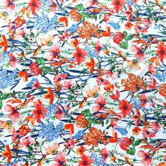 The Fabric Fairy Wildflowers on White Nylon Spandex Swimsuit Fabric